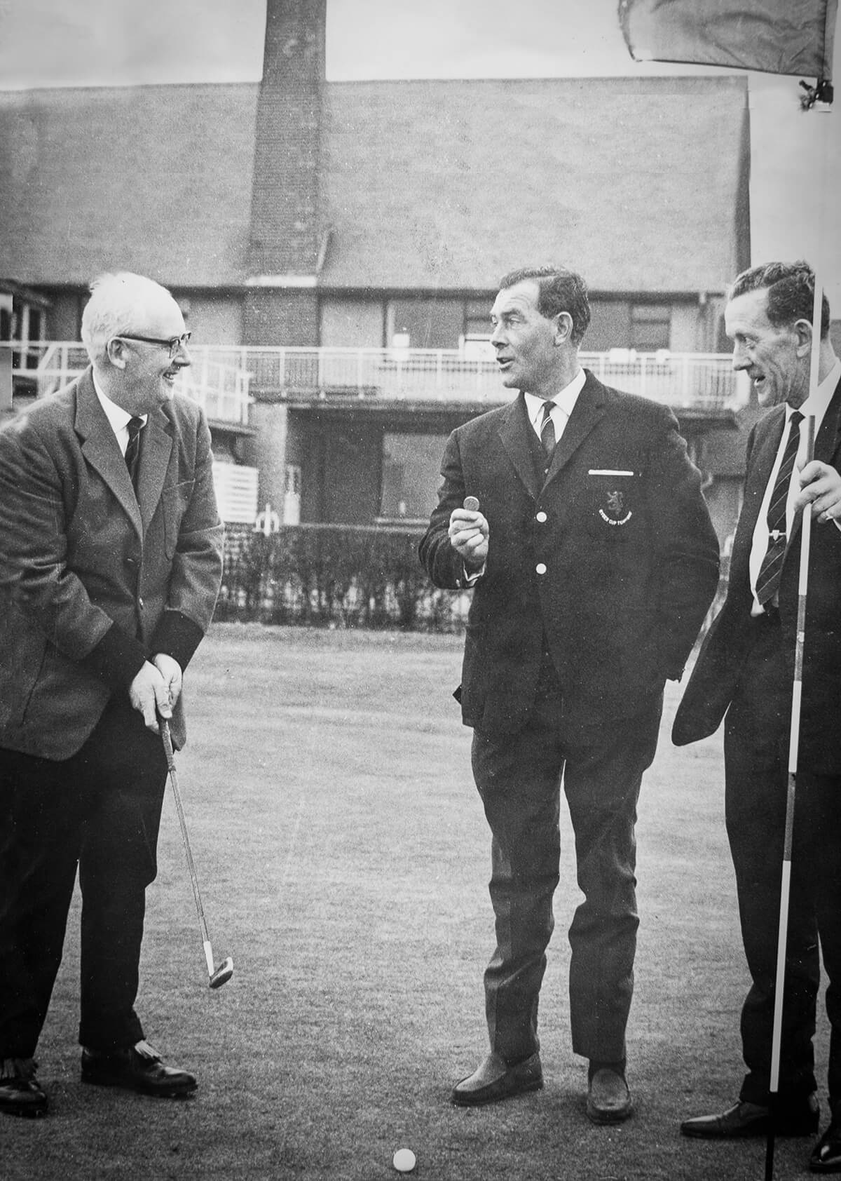 Captain's Drive in at Royal Dublin 1967. The Captain L.P. Gunning with Club Professional Christy O'Connor and outgoing Captain W.J. Howley on 18th Green.