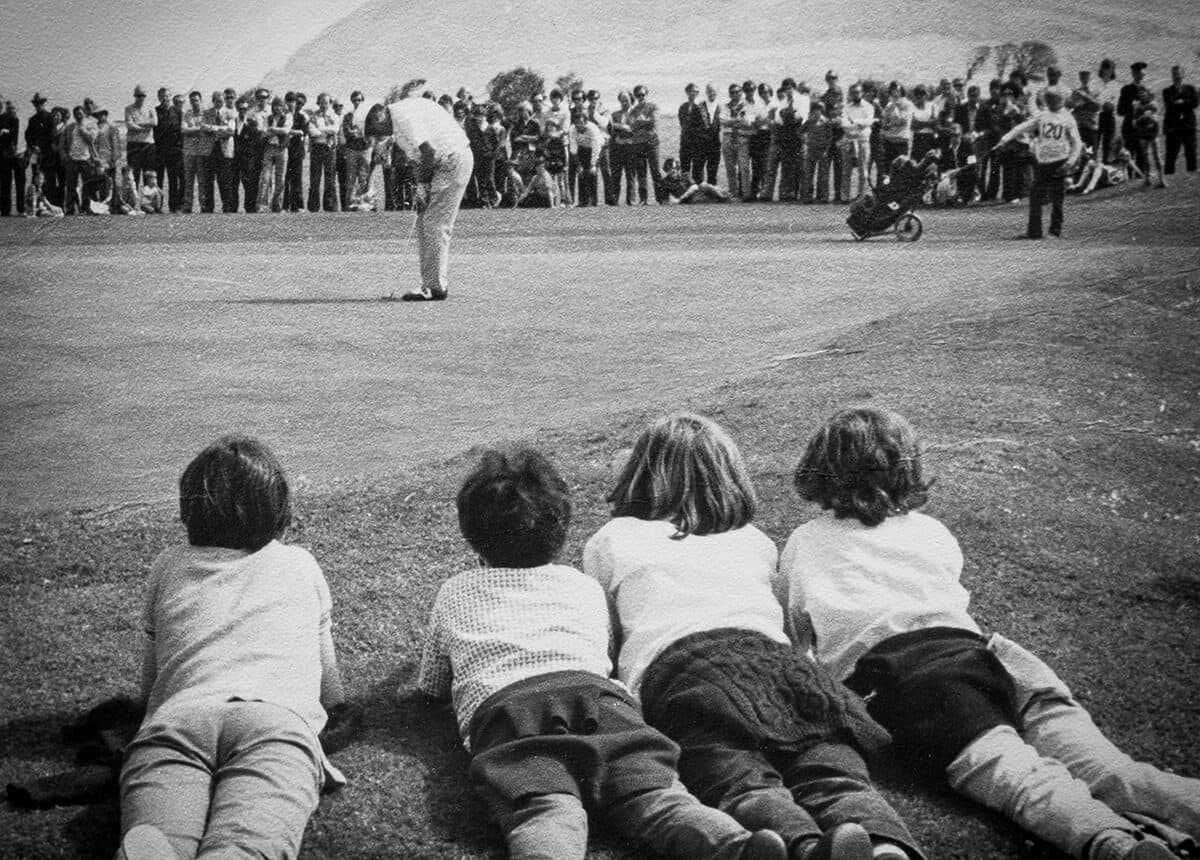 Christy O'Connor putting Carroll's International Tournament at Woodbrook 1973 with Bray Head in the background.